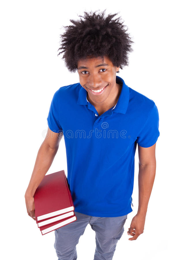 Young black teenage student men holding books - African people. Young black teenage student man holding books, isolated on white background - African people stock photo