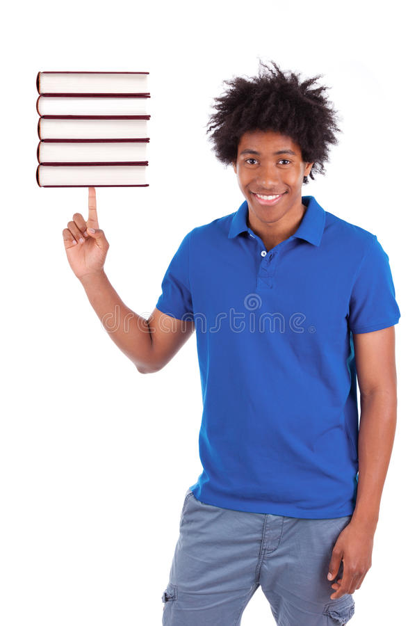 Young black teenage student men holding books - African people. Young black teenage student man holding books, isolated on white background - African people stock image