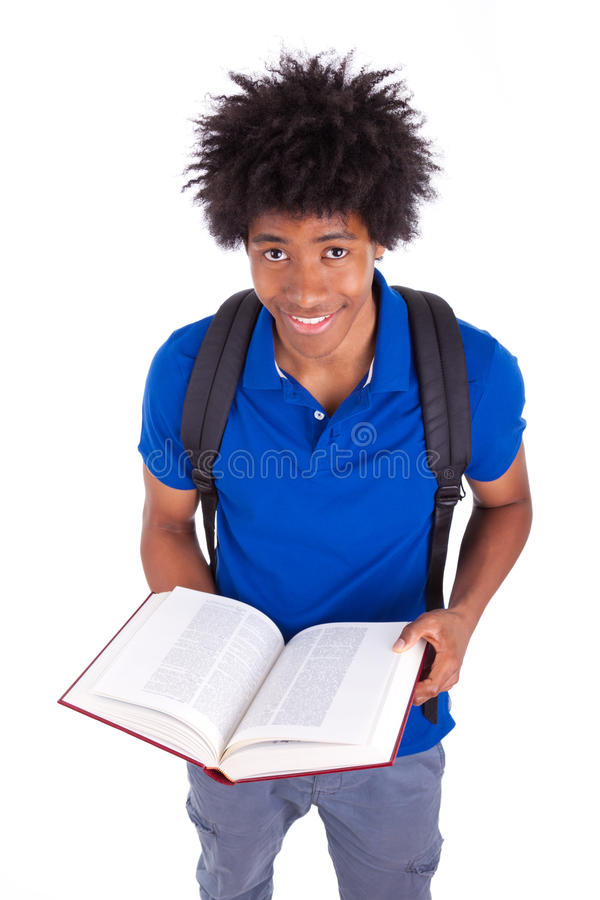 Young black teenage student men reading a books - African people. Young black teenage student man reading a books, isolated on white background - African people stock photography