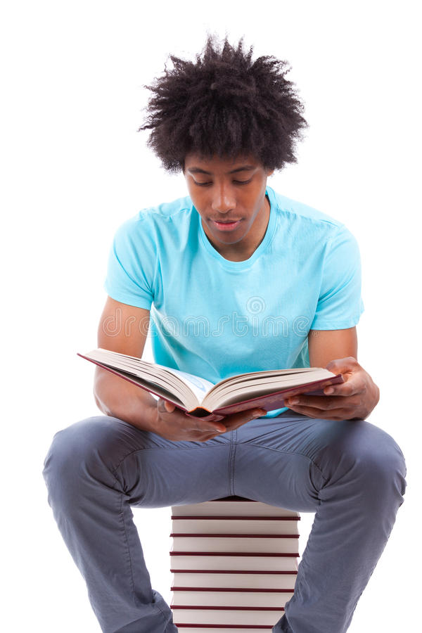 Young black teenage student men reading a books - African people. Young black teenage student man reading a books, isolated on white background - African people stock image