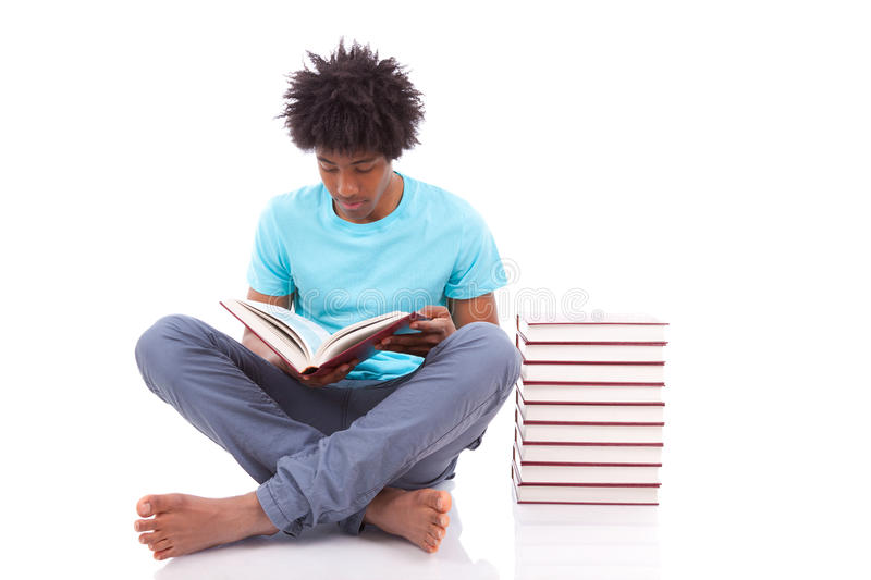 Young black teenage student men reading a books - African people. Young black teenage student man reading a books, isolated on white background - African people royalty free stock photography