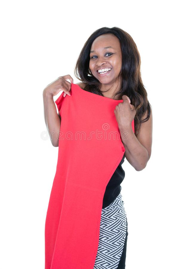 Young black woman african american choosing clothes red dress stock photography