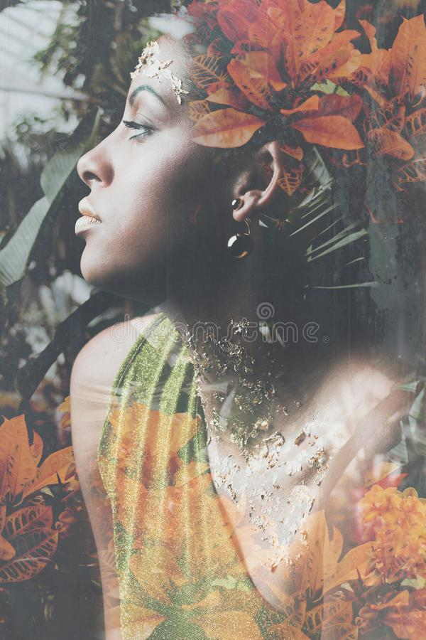 Young black woman fantasy portrait double exposure royalty free stock photo