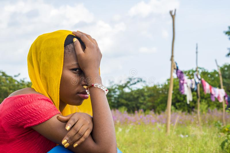 young black woman feeling sad and unhappy squatting outdoor close up royalty free stock photos