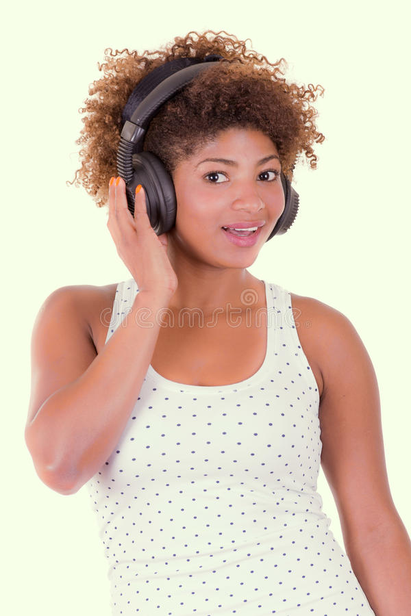 Young black woman listening music royalty free stock image