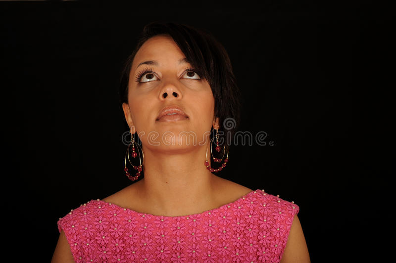 Young black woman looking up stock photography