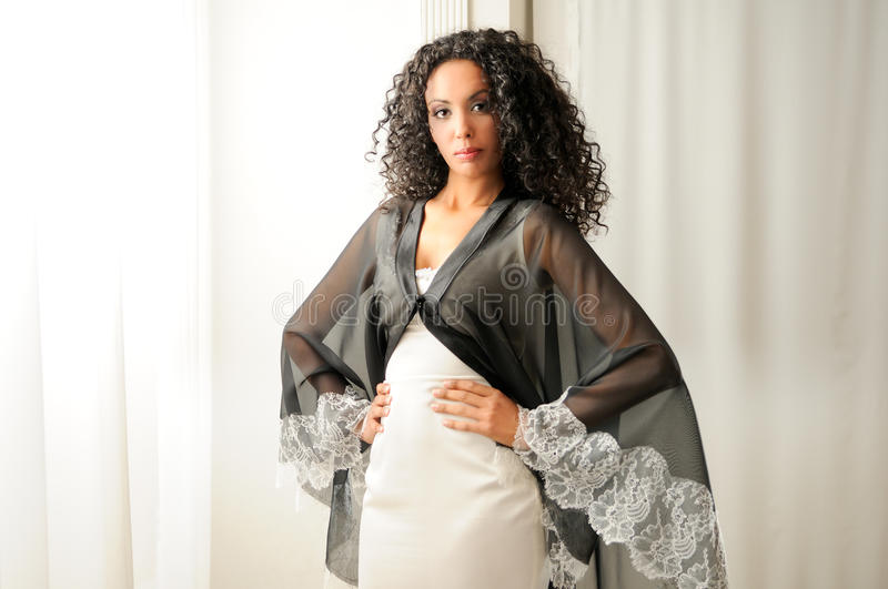 Young black woman with party dress. Portrait of a young black woman, model of fashion, with party dress stock image
