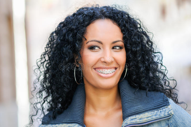 Young black woman smiling with braces stock photos