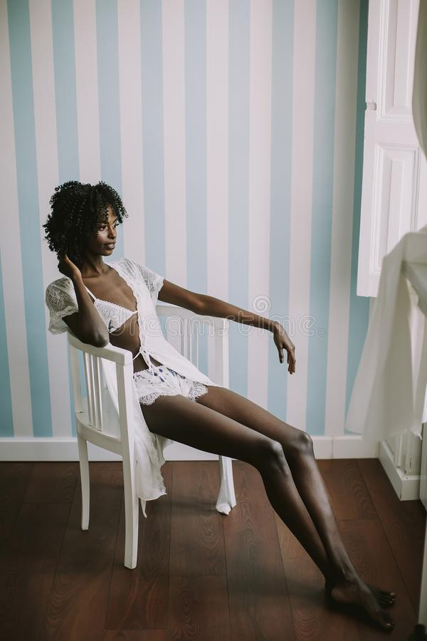 Young black woman in the white stock photo