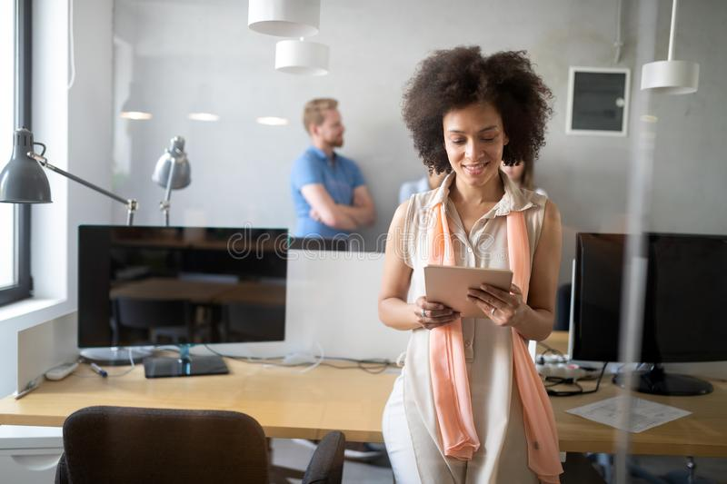 Young african american woman working with tablet in office royalty free stock photos