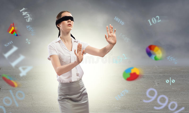 Young blindfolded woman stock photography