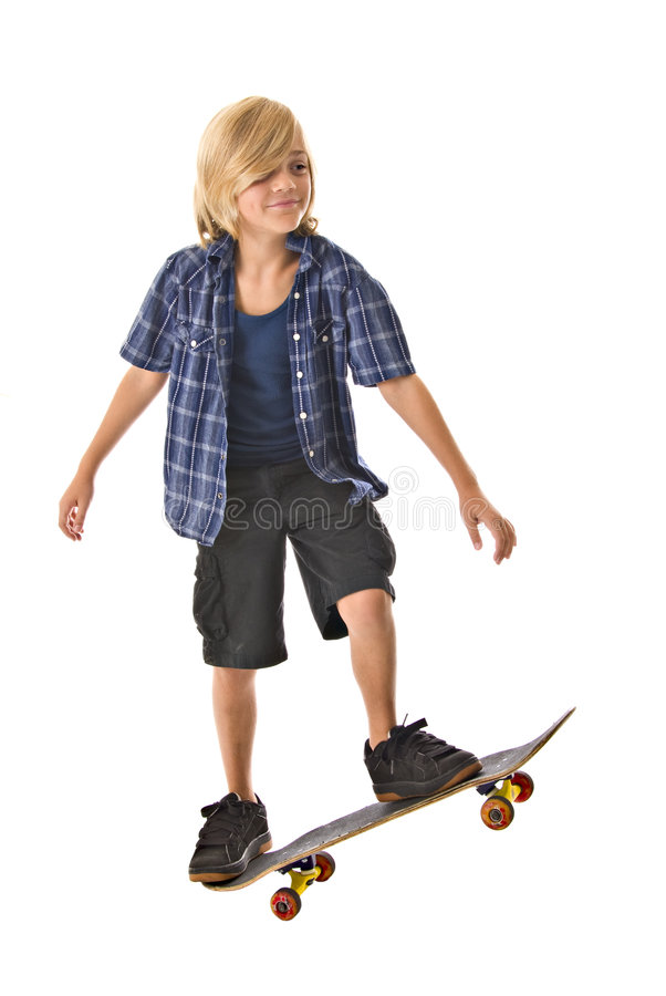 Young blond boy on skateboard. Adolescent blond boy on standing on skateboard isolated on white background royalty free stock image