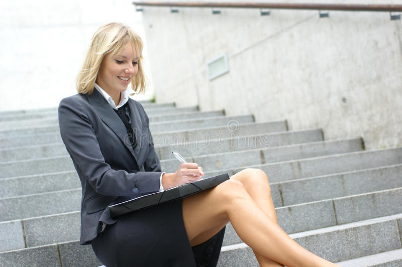 A young blond businesswoman in formal clothes