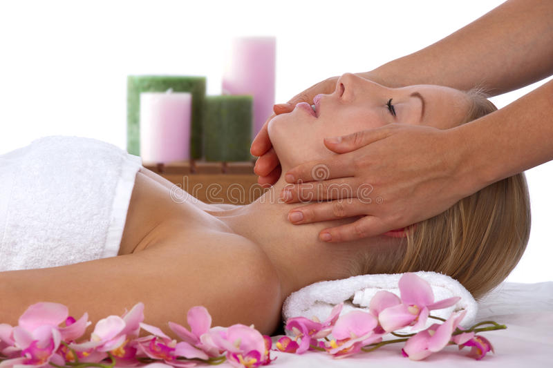 Young, blond caucasian woman in treatment at spa stock photography