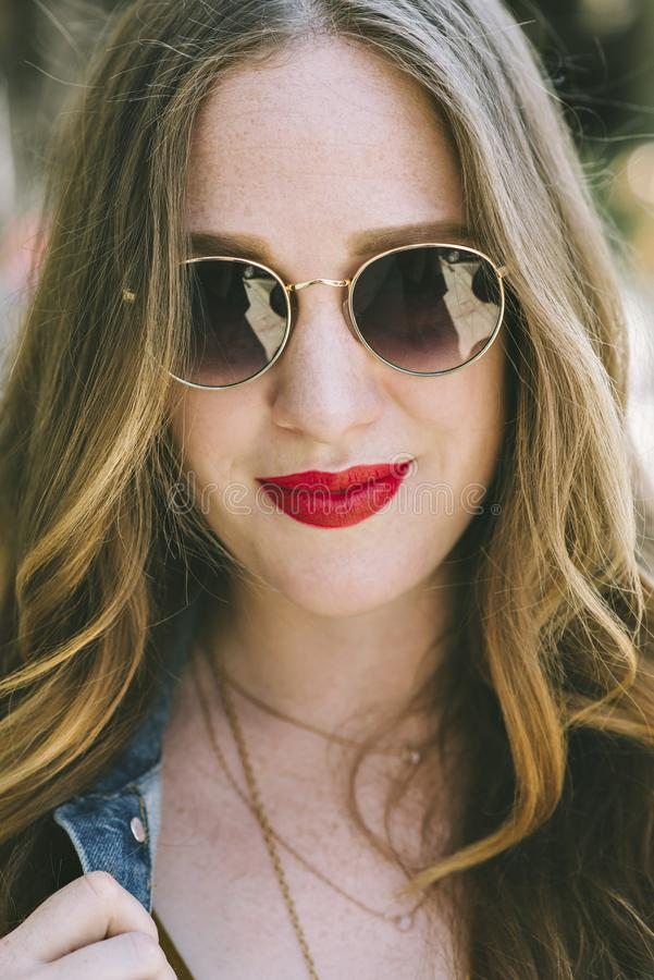 Young Blond Female with Shades and a Smile royalty free stock photo