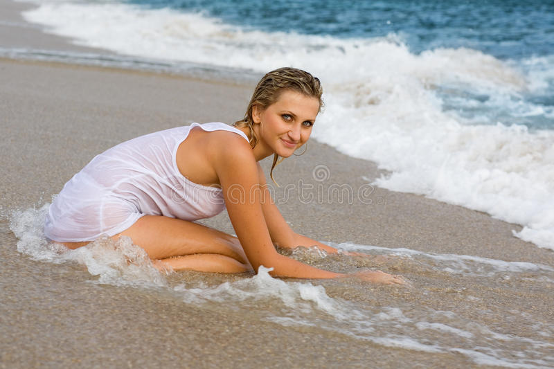 Young blond girl on the beach. royalty free stock images