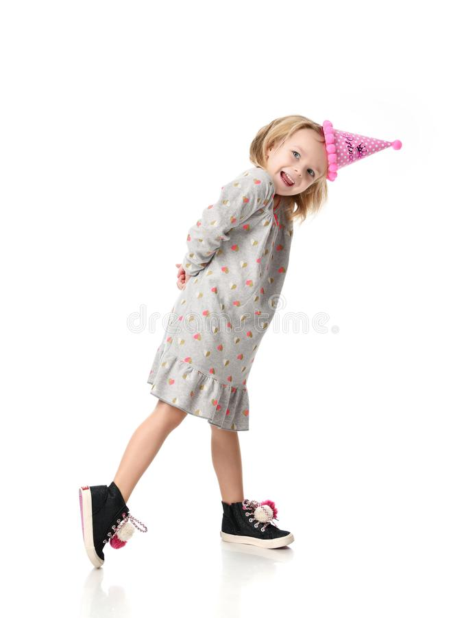 Young blond girl in birthday party princess hat happy smiling isolated on a white stock images