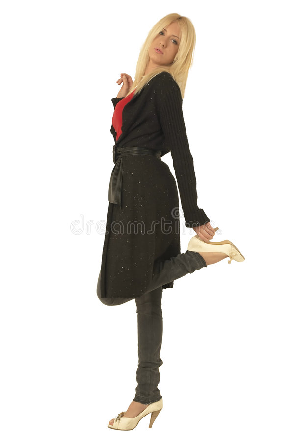 Young blond girl figure. Blondie with blue eyes. Figure of young girl.Girl standing on one leg stock image