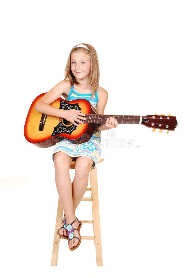 Young blond girl with guitar. stock photography