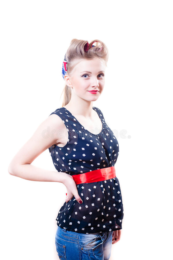 Young blond girl with hair curlers in polka dots stock photo