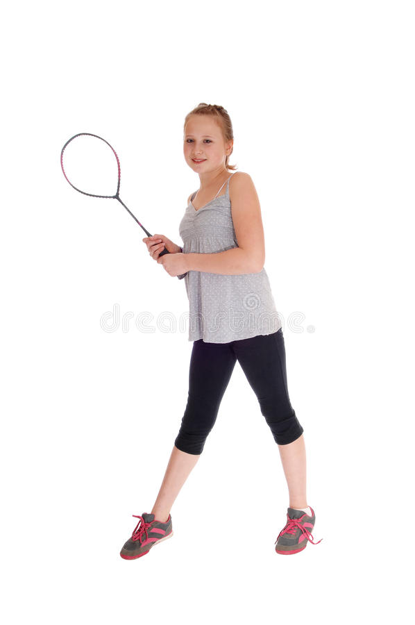 Young blond girl with her tennis racquet. stock photo