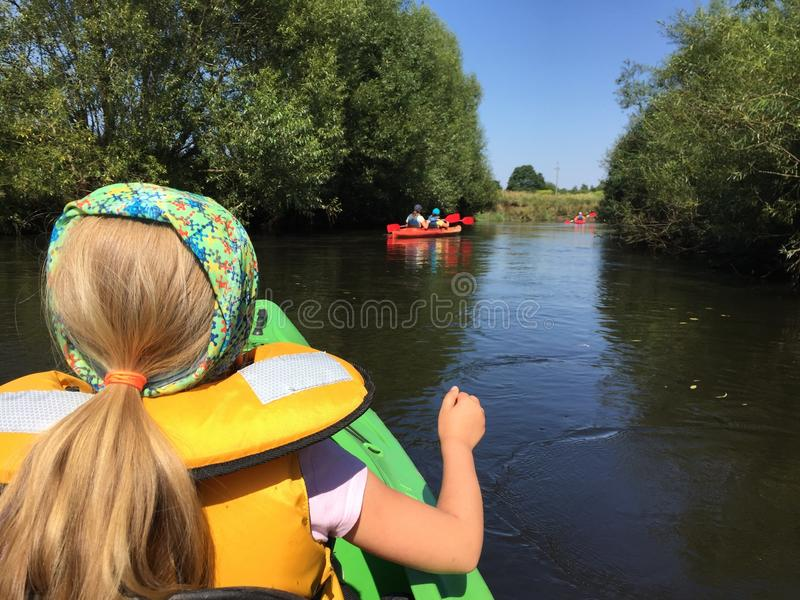 Girl in a kayak on Wieprza river, Poland stock image