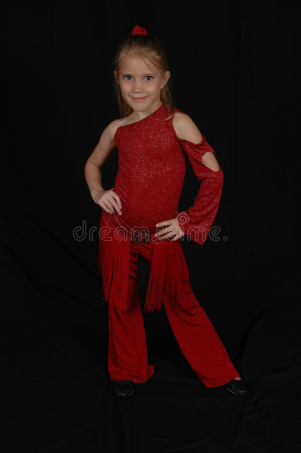 Young Blond Hip Hop Model. Young girl in a red dance outfit striking a pose. Child in her recital outfit. Portrait of a child taking dance lessons. Child with royalty free stock images
