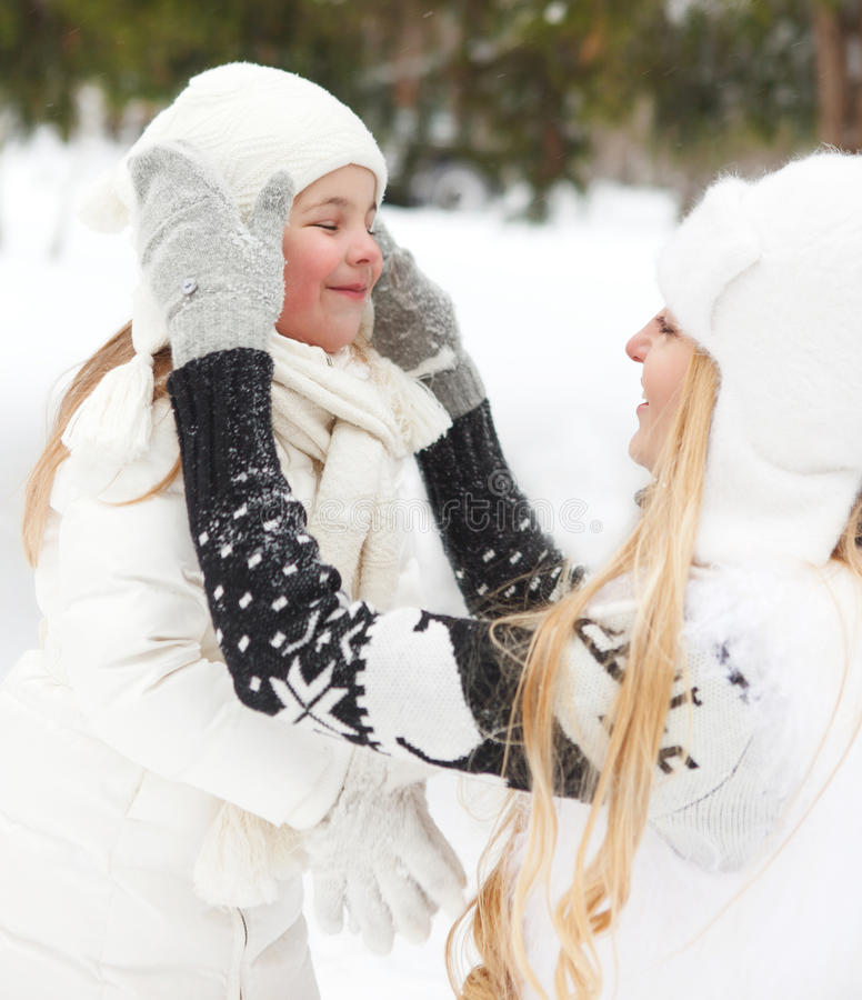 Download Young Blond Mother Takes Care Of Her Daughter Outdoors Stock Image - Image: 34351019