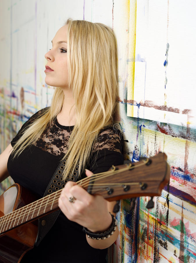 Young Blond Playing Guitar Stock Photography