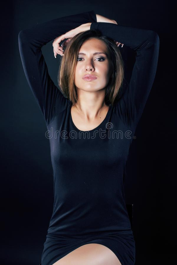 Young blond real woman emotional in depression dark indoor stock image