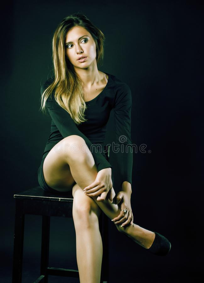 Young blond real woman emotional in depression dark indoor stock images