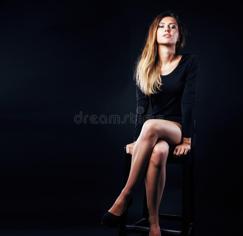 Young blond real woman emotional in depression dark indoor stock photo