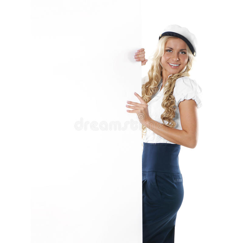 Download A Young Blond Sailor Woman Holding A Poster Stock Image - Image: 21107059