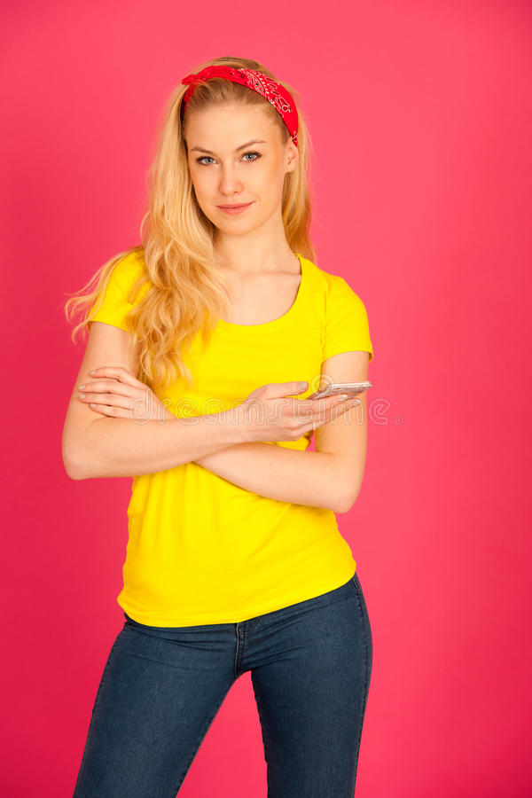 Young blond teenage girl in yellow t shirt surfing the web on sm stock photos