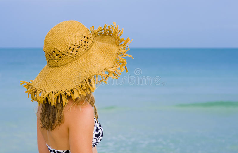 Young blond watching the sea stock image