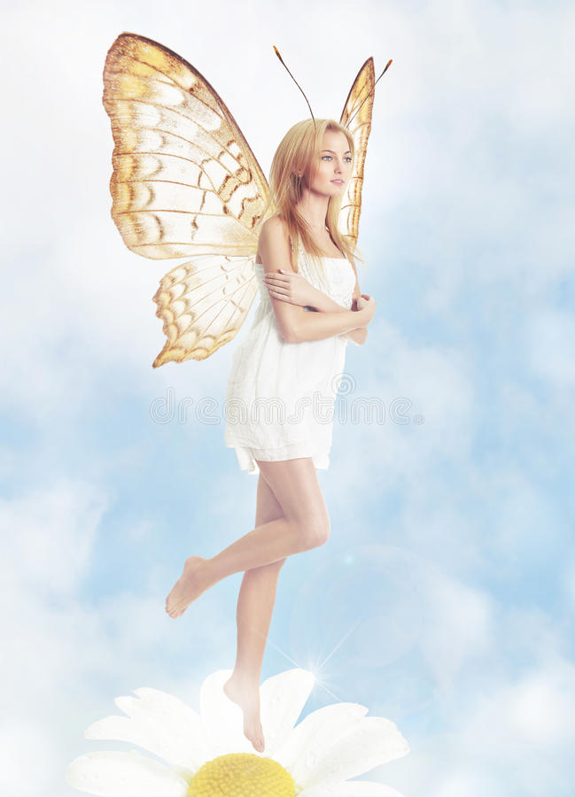 Young blond woman as butterfly royalty free stock image