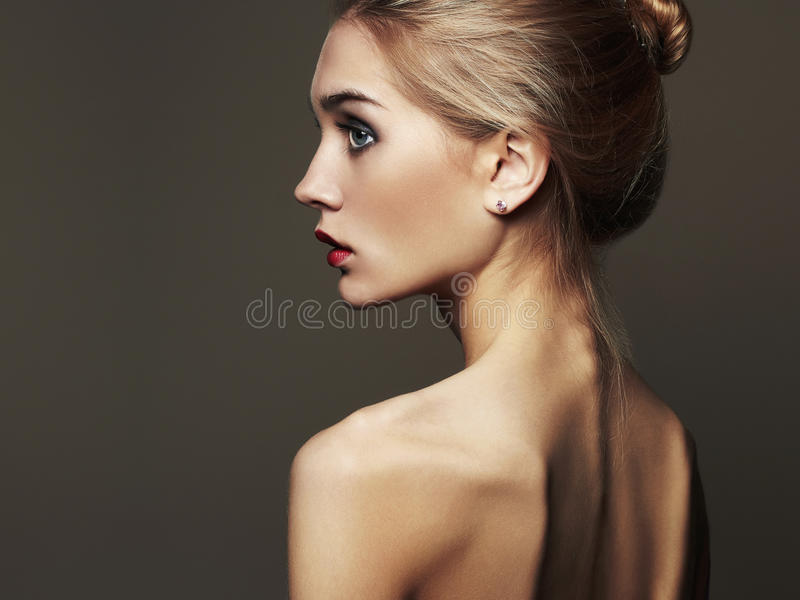 Young blond woman.Beautiful blonde Girl.close-up fashion portrait. Naked body royalty free stock images