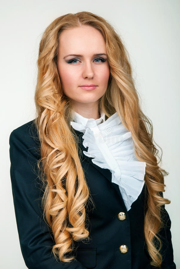 Young blond woman in a black suit royalty free stock photography