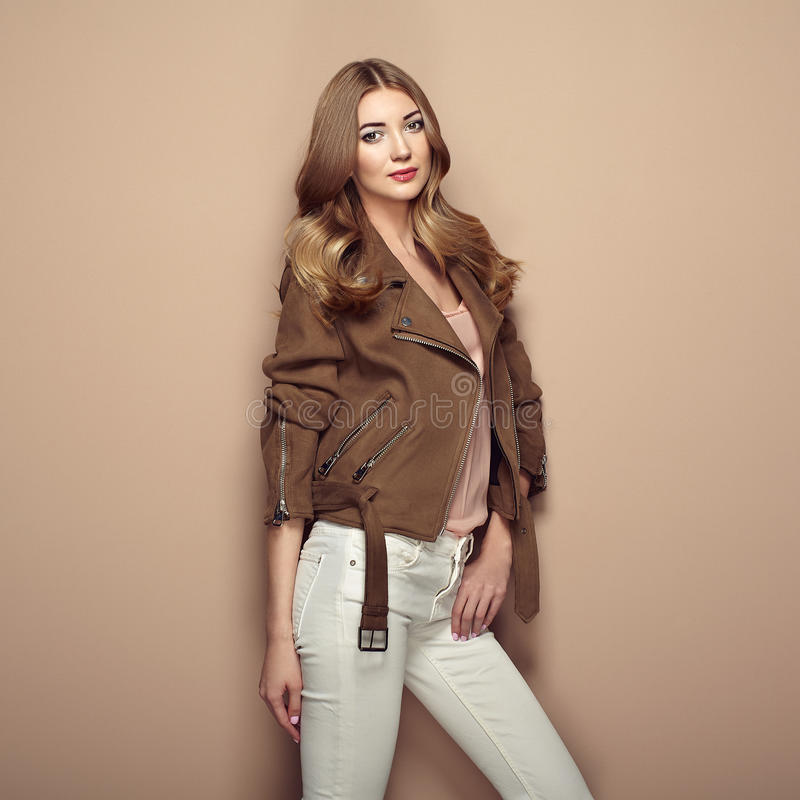 Young blond woman in brown jacket stock photography