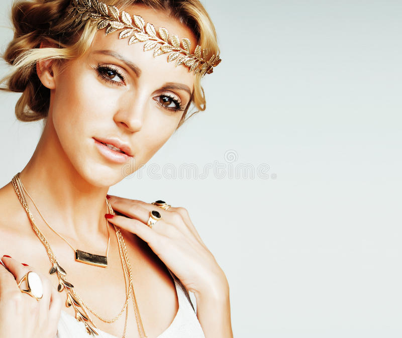 Young blond woman dressed like ancient greek godess, gold jewelry close up isolated, beautiful girl hands manicured stock photos
