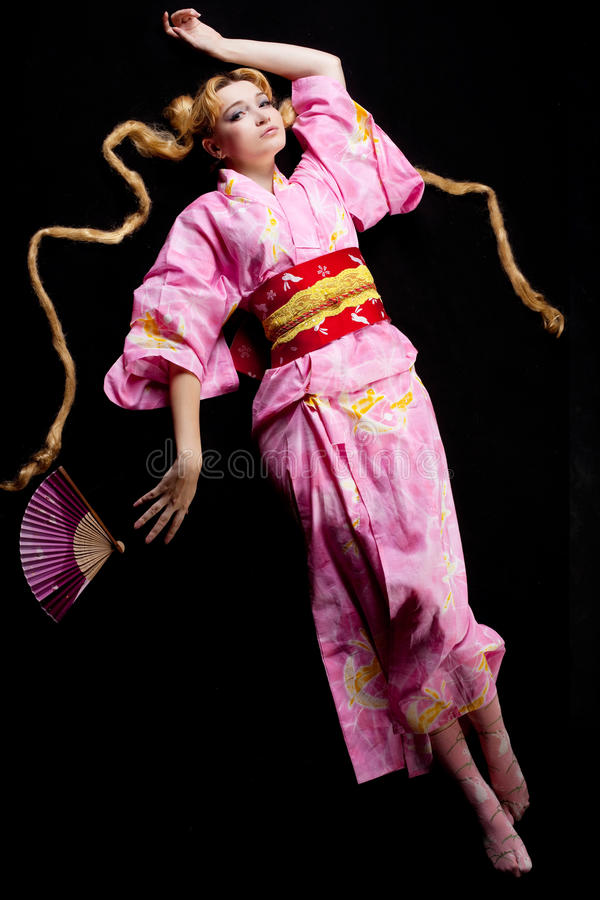 Download Young Blond Woman Lay In Japan Kimono On Black Stock Photo - Image: 21170940