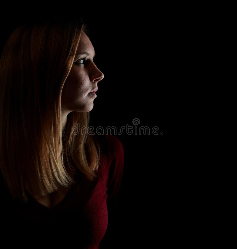 Young blond woman looks thoughtfully aside stock images