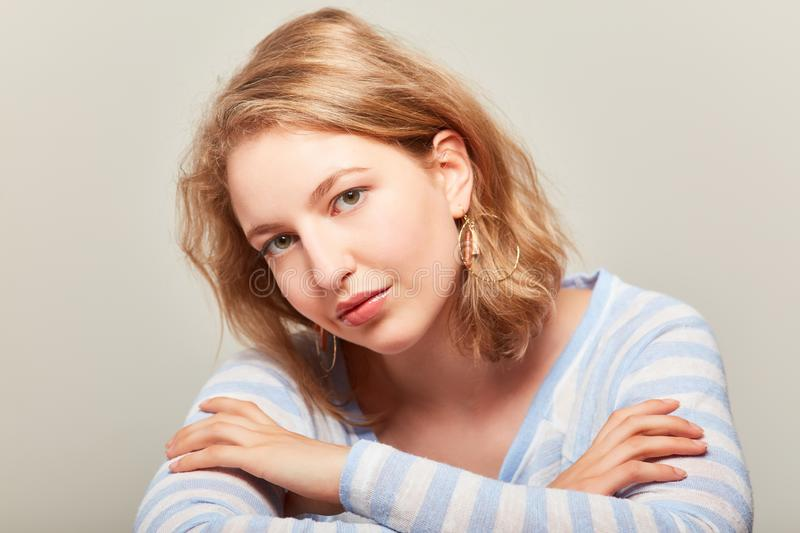 Young blond woman is looking into the camera royalty free stock photo