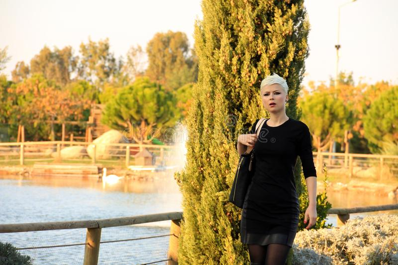 Young Blond Woman in Nature stock photo