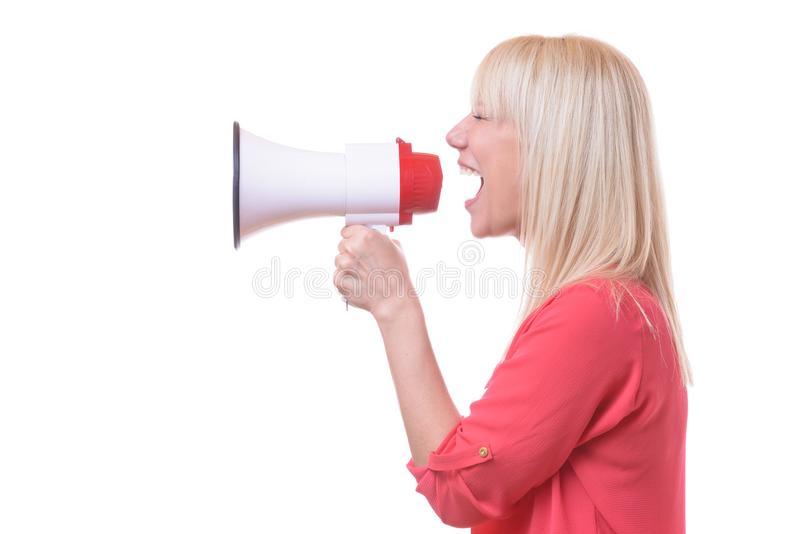 Young blond woman shouting into a megaphone. Or bull horn isolated on white conceptual of a demonstration or activism stock images