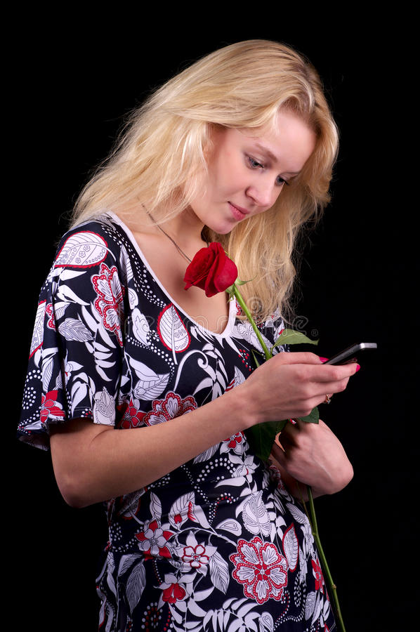 Download Young blond woman texting stock image. Image of black - 14854723