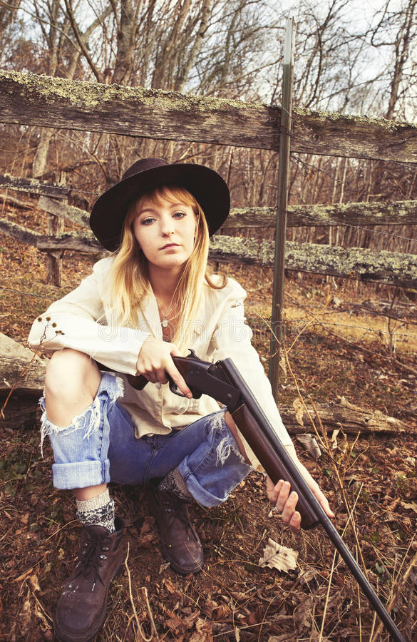 Download Young Blond Woman In The Woods With A Gun Stock Photo - Image: 83724832