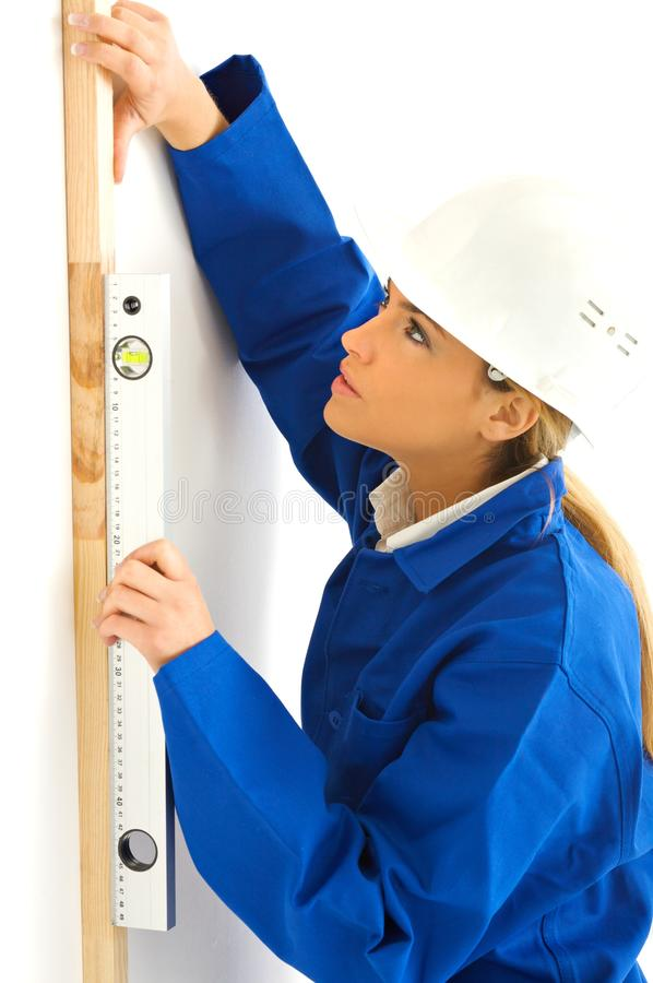 Young blond woman working stock images