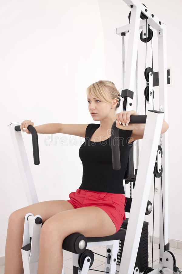 Free Young Blond Woman Workout In Gym Royalty Free Stock Photos - 10031038