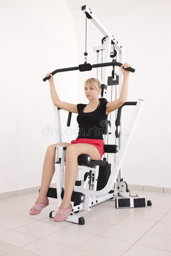 Free Young Blond Woman Workout In Gym Stock Photos - 9967053